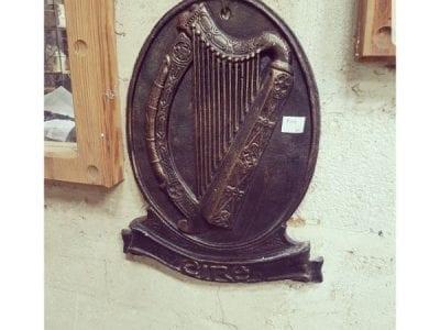 Cast iron harp plaque
